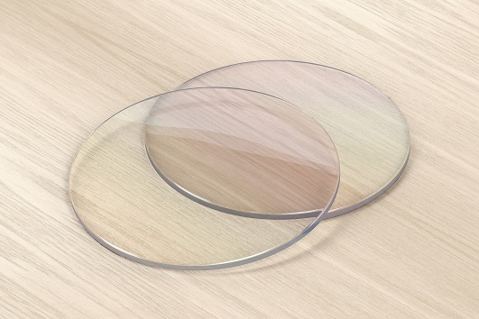 Pair of eyeglasses lens on wood background